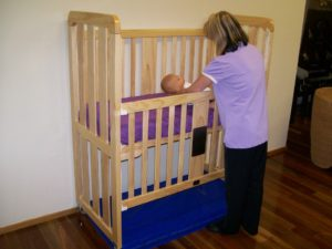 Baby being placed into a cot